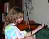 [Clara practicing on her new violin]